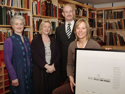 Edinburgh Makar Valerie Gillies, Linda Fabiani MSP, and Heather Stoddart, Surveyor for RCAHMS, present Fergus Waters, Director of the Scottish Mining Museum, with the archive image of Lady Victoria Colliery and specially commissioned poem