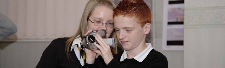 High schools workshop. Two young people looking at video footage, September 2006. DP013465
