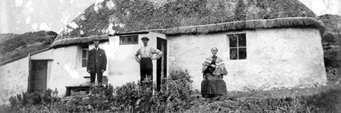 old cottage with people outside